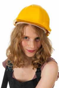 Portrait of female builder in studio
