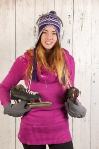 Woman in winter with ice skates