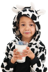 Little boy as cow drinking milk
