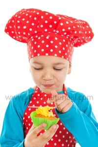 Boy is eating cupcake