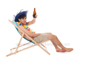Young man at the beach drinking beer